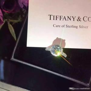 Новые женщины ювелирные изделия 925 серебряное кольцо с бриллиантом бренд роскошь форма High Carbon Алмазная Четыре лапка Круглый кольцо Простое кольцо Пара оригинальная коробка