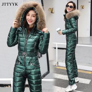 JTTYYK One Piece Лыжный костюм зимы женщин Мех с капюшоном Комбинезон хлопка проложенный Пояса Parka Комбинезоны Комбинезоны Zipper костюмы Y200904