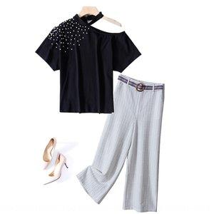 Matai Shenzhen butik moda rahat takım elbise kadın yaz yeni pantolon yuvarlak boyun üst + bağcıklı geniş bacak tro çizgili boncuklu Geniş bacak pantolon top