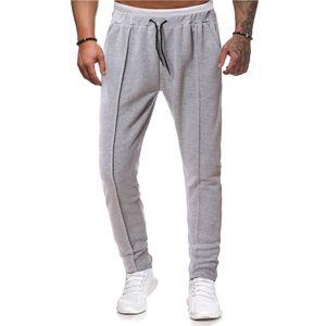Mens Сплошные цвета Спортивные штаны Узелок Сыпучие Skacked Брюки Мужской Фитнес Street Wear