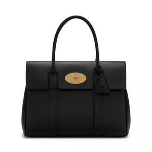 Designer women handbags Luxury soft cow leather 38cm width travel Totes metal button first hand prices free shipping