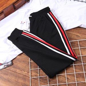 DONAMOL las mujeres de Corea del Estudiante Sweatpants suelta el otoño de 2020 nuevos pantalones de remiendo rayado ocasional pantalones Harem Femme Plus CX200807 tamaño