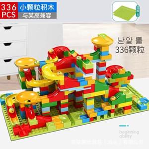 diapositiva pequeña partícula de los niños la construcción de bloques de montaje y la inserción de los juguetes del piso para niños y niñas, educación de la primera compatible con Lego