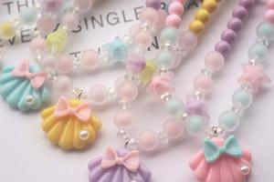 فتاة الاطفال مجوهرات جديدة الكورية الأطفال قلادة فتاة سوار اكسسوارات كاندي شركة شل بيرل الطفل قلادة سوار مجوهرات هدية عيد الميلاد
