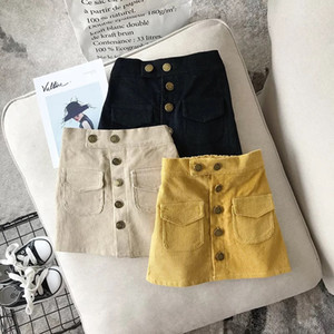 Nuovo INS Elegante bambini Tutu Ragazze Gonne Button Solid ragazze del pannello esterno di autunno della molla per bambini vestiti di cotone velluto a coste della neonata del bambino Gonne