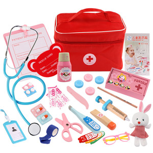 Children wooden toys, imitation cloth bags filled with medicine boxes, boys and girls over a doctor injection, toys and gifts