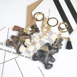 Nueva moda llavero lindo estilo oso de piel sintética borla de cuero simple decoración bolsa colgante coche llavero accesorios regalo gota envío envío