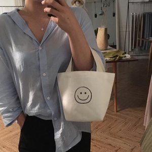 Bolsa de mano Corea 2020 Nuevo respetuoso del medio ambiente del bolso del almuerzo padre-hijo Bolsa lindo y hermoso sonriente de la cara del bolso de mano