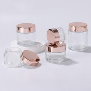 Nuevas botellas de crema de frascos de vidrio transparente Redondos tarros de cosméticos Frascos de crema de cara de mano con tapa de oro rosa 5g - 100 g