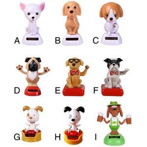 Auto Ornament ABS Solarbetriebene Kopfschütteln Puppe Swing Head Hund Automobil-Dekoration Spielzeug Auto dekorative Hund Puppe Dekor-Geschenk