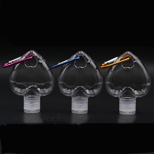 حار 50ML شكل قلب زجاجة المطهر من ناحية مع حلقة رئيسية هوك زجاجة من البلاستيك الشفاف لإعادة الملء السفر زجاجة الرئيسية لهجات T2I51380
