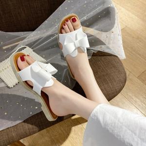 KHTAA zapatillas de verano 2020 Zapatos grande del arco-nudo para las diapositivas de las mujeres ocasionales de la playa cuero de las señoras sandalias planas al aire libre Mujer Calzado
