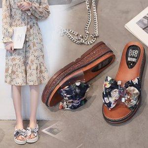 2020 Sommer neue Sandalen und Pantoffeln Hausschuhe Damenschuhe starke untere Keil Bogen Online beliebten koreanischen Stil Allgleiches Outdoor-Sandalen wo