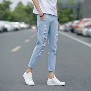 Hong Kong Fengchun summer water wash white hole youth all-match men's nine-point jeans Korean-style slim leggings tide