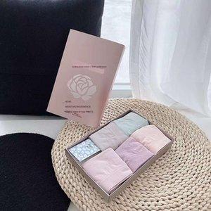 Nueva aceite esencial de rosa ultra-elástica transpirable ropa interior femenina de mitad de la cintura de la ropa interior de perfume amoniaco desnuda cadera de las mujeres con perfume