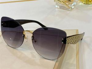 Nuevo diseño de moda mujer gato encantador gafas de sol del ojo 2021 sin marco vanguardista diseño popular UV400 gafas de protección