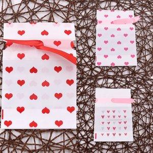 bolsa de 12 * 17 cm de caramelo bolsa de regalo de la mariposa de bolsillo paquete de cinta de plástico bowknot lindo regalo de Navidad