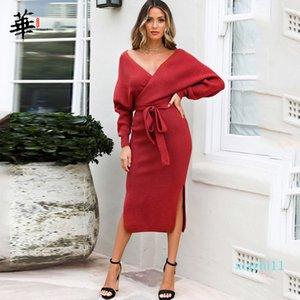 Venta caliente de la nueva del otoño cuello en V con la cruz de la correa del suéter de punto las mujeres se visten de Split delgados 2020 de invierno de manga larga de color sólido elegante de las señoras