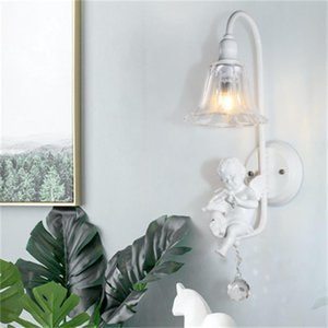 Modern and simple E14 resin angel blowing horn bird bedroom bedside lamp wall lamp led crystal glass wall lights