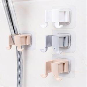 1Pcs portátil Chuveiro Shelf Chuveiro rack auto-adesivo plástico sem punch Duche aspersão Acessórios Titular do banheiro