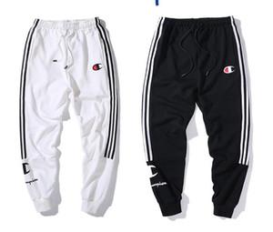 El nuevo diseñador de pantalones para hombre Harem Joggers sudor de los pantalones elásticos de la entrepierna del manguito gota Joggers hip hop pantalones para las mujeres de los hombres Negro Blanco Champ pantalón