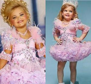 Schöne Eden Wood Rosa Baby-Kleinkind-Festzug-Kleider für Mädchen Glitz Strass Ballkleid rosa gefiederten Kinder Partykleider