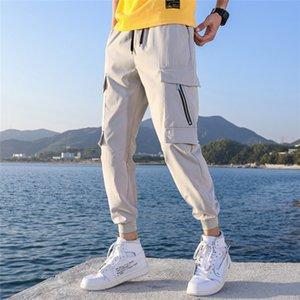 Erkekler Pocket Patchwork Bahar Casual Pantolon Gevşek Çizim Mens Tasarımcısı Capris Pantolonlar için Serbest Kargo Pantolon