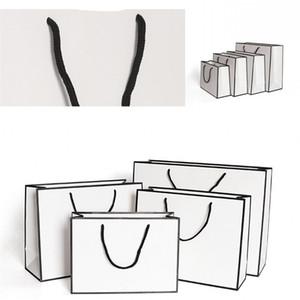 Kraft Paper Bags addensare Carta bianca confezione sacchetto Pubblicità Moda bagagli borsa di acquisto del partito su misura Abbigliamento 1 86gr B2
