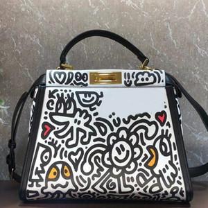 Gran capacidad del paquete bolsas de mano bolsa de viaje gráfico de la moda de impresión remiendo de cuero genuino del color de dibujos animados patrón de las mujeres del bolso de Crossbody