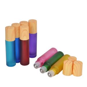 10ML الأساسية الرول النفط الكرة زجاجة الملونة غطاء الخشب من الضروري النفط زجاجات الأسطوانة الملء الحاويات KKA8011