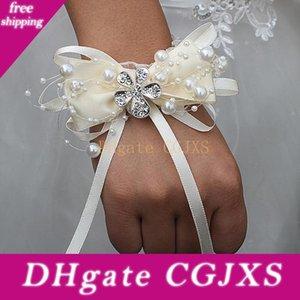Marfim Ivoire Noeud papillon perle perlée de mariage poignet Fleurs demoiselle d'honneur De Ruban Mariage Cristal corsages Fleurs Wristband