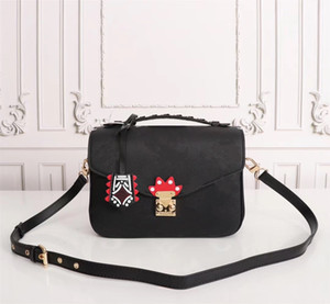 CRAFTY POCHETTE MÉTIS Embossed Leather Extra-large Print Letters Braided Top Handle Graffiti Inspired Charm Shoulder Crossbody Bag