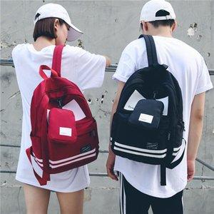 Дизайнер-Оптовая Нейлон Повседневный Студент Backpacks 2018 Новая корейская версия колледжа Wind Back Pack Высокое качество 2pcs 4 цвета