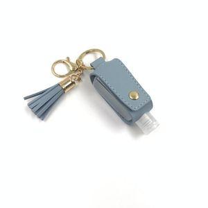 Botella desinfectante de la mano de la PU de cuero de la borla del sostenedor del keychain Llavero Protable cubierta bolsas de almacenamiento de la casa para guardar Organización DHF728