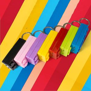 100pcs / Lot LED bunte Brick Schlüsselanhänger Baustein Spielzeug für Kind-Geschenk Kompatible Taschenlampe Brick Schlüsselanhänger Taschenlampe Schlüsselanhänger