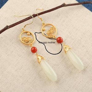 fjkGC Bohui S925 Hetian gümüş eardrop ea iQecE eardrop Beyaz Jade Lotus zarif Beyaz kadın sterlini hepsi maç Jade küpe gümüş kakmalı