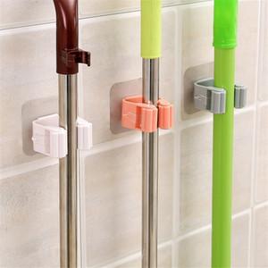 Montado en la pared de la fregona Sostenedor de cepillo de escoba Percha Rack de almacenamiento organizador de la cocina de montaje con colgantes de accesorios de limpieza Herramientas