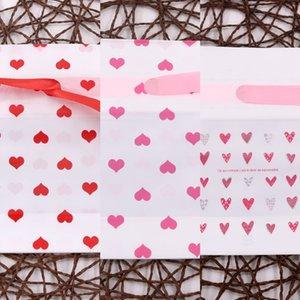 bolsa 12 * 17cm caramelo de la cinta de plástico de bolsillo bolsa de regalo paquete de mariposa del bowknot lindo regalo de Navidad