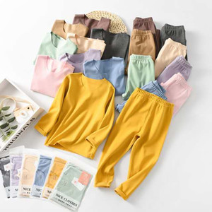 Niños ropa interior caliente de los cabritos determinados largos de la manga 2 piezas de ropa chicos, chicas, traje pijama de color caramelo sólido puro