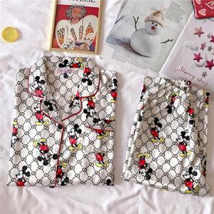Manga par pijamas Set Nueva delgada impresa flor seda dormir Conjunto de pijama largo Pijamas Hombre mujeres flojas ocasionales de los hombres pijamas Homewear Y # 407