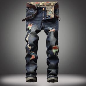 rua EVJSUSE personalidade pintadas homens jeans reta calças jeans dos homens buracos abrasão manual rasgado azul retro