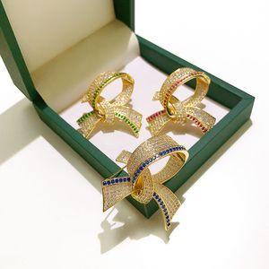 L'oro Uomini Wedding Party Dress Donne Suite Pins Giallo placcato CZ Bow Spille Pins per gli uomini regalo donne calde