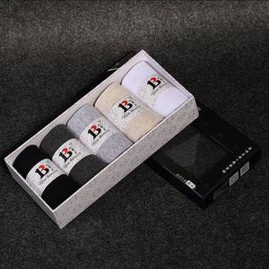 Shixiang tricotée aromathérapie commercial haut de gamme de quatre hommes seasons aromathérapie et chaussettes simples de couleur unie chaussettes hommes boîte-cadeau
