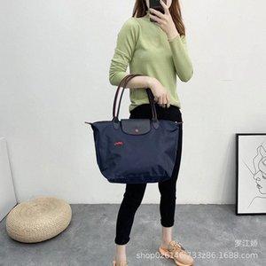 Nouveau brodé cheval Jiao Zi Bao vrac sac imperméable Tuo Te Bao Sac à bandoulière en toile Sacs à main pour les femmes des hommes Messenger Bag OMPl #