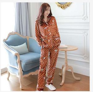El último otoño / invierno de las mujeres pijamas de manga larga, celebridad web con el mismo conjunto de lujo de terciopelo de oro fresca pequeña ropa para el hogar