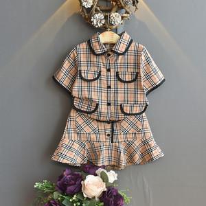 Лето 2pcs ребёнки отворот футболки плед юбка Экипировка Короткие Дети Топы Юбки Дети Мода Одежда малышей Одежда наборы