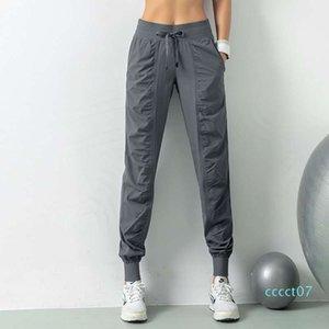 Женщины студии йоги Брюки женские быстро сохнут кулиской Running спортивные брюки Сыпучие Dance Studio Jogger Девушки Йога штаны Gym Fitnect07