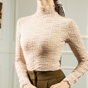 con botones en el cordón de la blusa femenina otoño / invierno versátil vestido nueva tendencia ins camiseta de manga larga de cuello alto celebridad web temperamento delgado