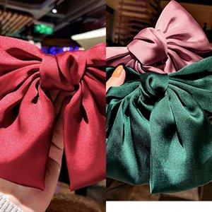 Zhou Yangqing arco tornante jk super grande farfalla farfalla rossa arco tornante stile coreano clip superiore clip di rimbalzo