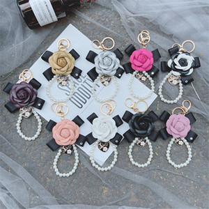 Fashion New Bowknot Camellia Keychain Creative Pearl Chain PU Leather Rose Flower Bag Car Keychain Pendant Accessories